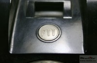 White button with PTT logo