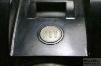 Wit knopje met PTT-logo