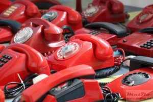 a small collection of red phones
