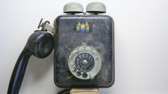 Fake telephone front